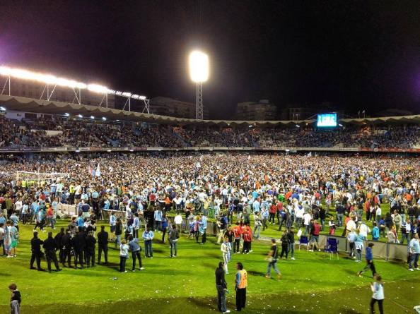 Celta fans flood the pitch after winning Saturday to secure two things: their own survival and Deportivo's doom. Machiavellian, really.